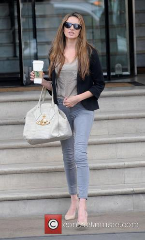 Nadine Coyle - Nadine Coyle leaves The Langham Hotel with a large cup of Starbucks coffee - London, United Kingdom...