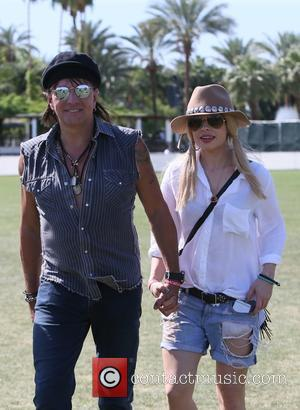 Richie Sambora and Orianthi - Richie Sambora and girlfriend Orianthi seen attending Coachella day three of week one at Coachella...