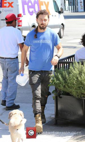 Shia LaBeouf - Shia LaBeouf, sporting a long ponytail and a silver love heart ear stud tucks into a salad...