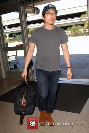 Steven Yeun - Steven Yeun arrives at Los Angeles International (LAX) airport to catch a flight at LAX - Los...