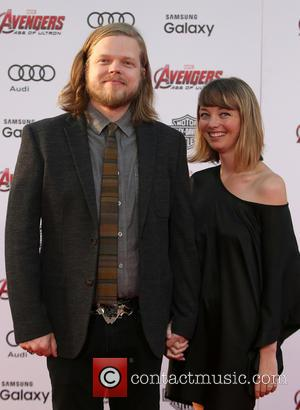 Elden Henson and Guest - Shots of a host of stars as they attended the premiere of Marvel's