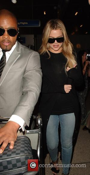 Khloe Kardashian - Khloe Kardashian arrives back on a flight from Armenia at Los Angeles International Airport (LAX) at LAX...