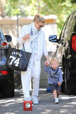 Fergie and Axl Duhamel - Fergie takes her son Axl Duhamel to a park in Brentwood, wearing all white and...