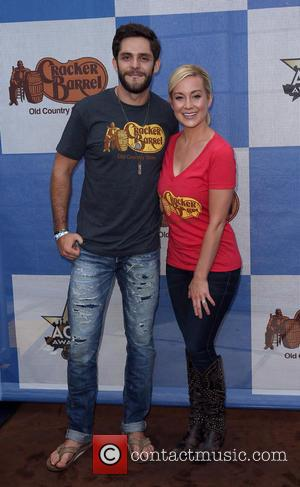 Thomas Rhett and Kellie Pickler - Cracker Barrel Old Country Store Country Checkers Challenge During ACM Party for a Cause...