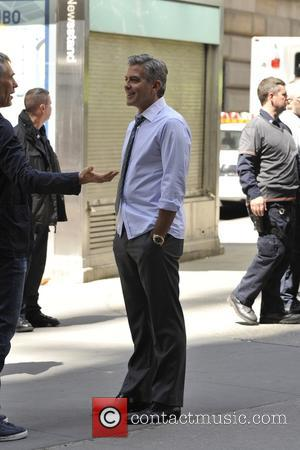 George Clooney - George Clooney, Julia Roberts, Jodie Foster, and Jack O'Connell on the set filming 'Money Monsters' - New...