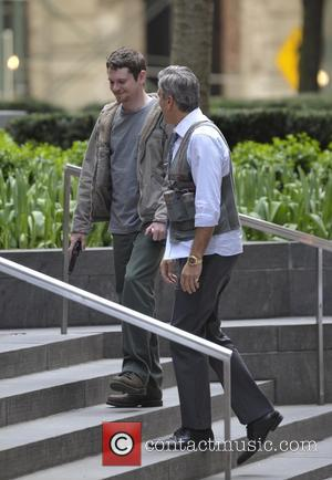 George Clooney and Jack O'Connell - George Clooney and Jack O'Connell on set filming 'Money Monsters' - Manhattan, New York,...