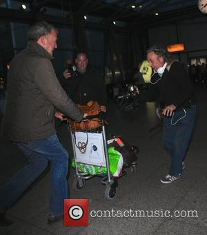 Jeremy Clarkson - Jeremy Clarkson lunges his luggage trolley at photographers at Heathrow Airport, after returning from Istanbul - London,...