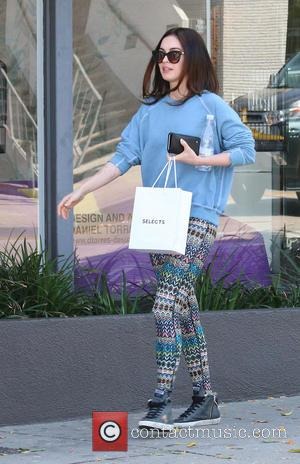 Hollywood star Megan Fox was spotted as she left a hair salon in sporting a pair of colorful tribal patterned...