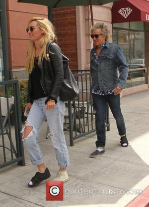 Rod Stewart and Penny Lancaster - Rod Stewart and his wife Penny Lancaster leaving the doctors office with matching medical...