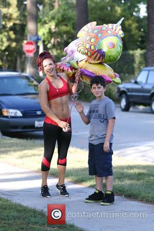 Sharna Burgess - DWTS dancer Sharna Burgess gets stopped by a fan in the street and given good luck balloons....