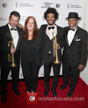 Jc Hopkins Biggish Band Members Claire Daly (2nd L), Wayne Tucker and Solomon Hicks