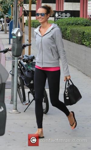 Stacy Keibler - Stacy Keibler out and about in West Hollywood in mirrored sunglasses and sportswear - Los Angeles, California,...