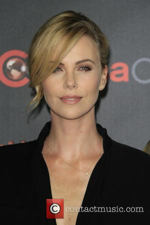 Charlize Theron - Shots of a host of stars as they arrived for the 2015 CinemaCon which was held at...