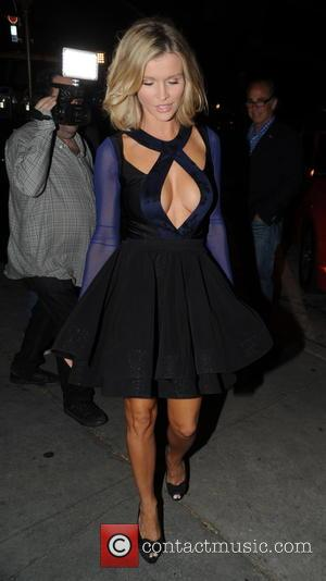 Joanna Krupa - Joanna Krupa has dinner at Craig's in Hollywood showing her cleavage in a short cross strapped dress...