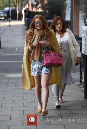 Lindsay Lohan - Lindsay Lohan leaving Scott's restaurant in Mayfair, with a female companion. Lindsay was spotted embracing an older...