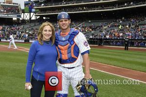 Edie Falco - Edie Falco throws out the first pitch at the New York Mets game at Citi Field in...