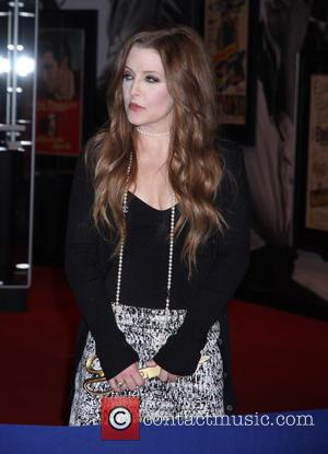 Lisa Marie Presley - Priscilla Presley and Lisa Marie Presley open the new 'Elvis: The Exhibition-The Show-The Experience' at Westgate...