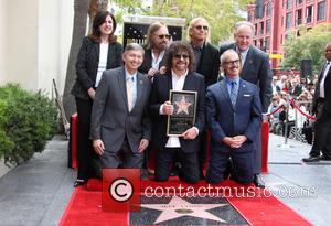Maureen Schultz, Leron Gubler, Jeff Lynne, Mitch O'farrell, Tom Petty, Joe Walsh and Tom Labonge