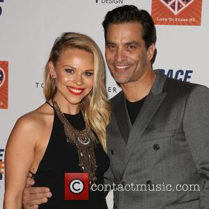 Julie Solomon and Johnathon Schaech