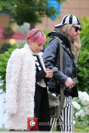 Nicole Richie and Gregory Russell - Nicole Richie films a segment for her reality show 'Candidly Nicole' at The Americana...