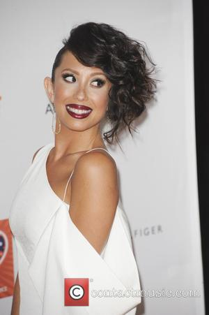 Cheryl Burke - 22nd Annual Race To Erase MS at Hyatt Regency Century Plaza - Los Angeles, California, United States...