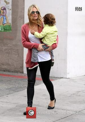 Molly Sims and Brooks Stube - Molly Sims carries her little boy Brooks whilst out in Beverly Hills - Los...