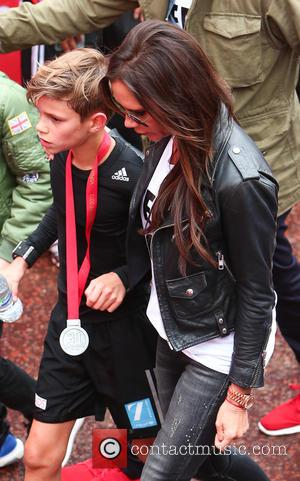 David And Victoria Beckham Cheer On Son Romeo During Charity Race
