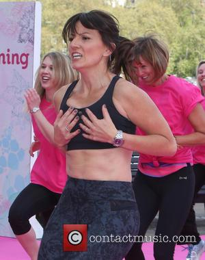Davina McCall - Davina McCall on the Southbank filming 'This Morning' outside ITV studios - London, United Kingdom - Monday...
