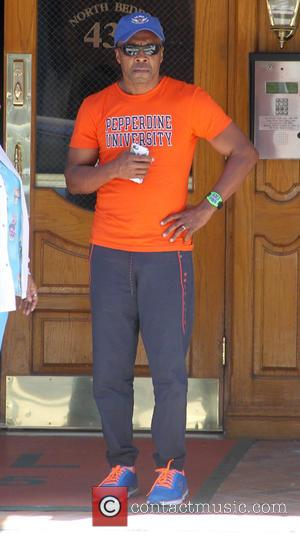 Sugar Ray Leonard - Sugar Ray Leonard waits outside an office in Beverly Hills wearing orange and blue Pepperdine University...
