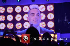 Robbie Williams performing live (on screen) - DRIVE Volkswagen Group Forum Opening - Arrivals - Berlin, Germany - Tuesday 28th...