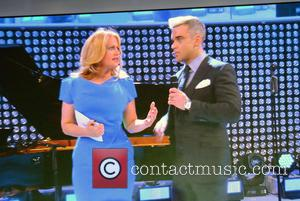 Barbara Schoeneberger and Robbie Williams On Screen