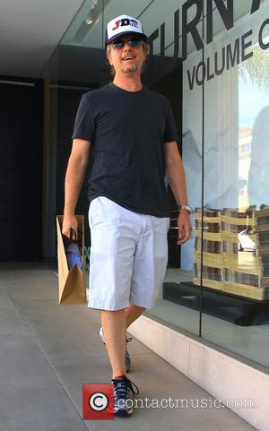 David Spade - David Spade and leaving James Perse in Beverly Hills - Beverly Hills, California, United States - Wednesday...