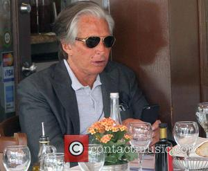 George Hamilton - George Hamilton has lunch in Beverly Hills wearing gold rimmed aviator sunglasses - Los Angeles, California, United...