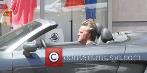 Matthew Perry - Matthew Perry smokes a cigarette while driving in his gun metal Audi R8 in Beverly Hills -...
