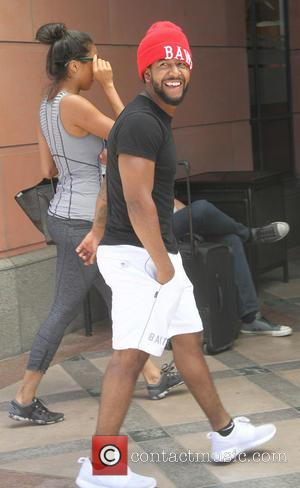 Omarion - Omarion and Apryl Jones leave an office on Bedford Drive - Los Angeles, California, United States - Wednesday...