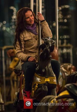 Juliette Lewis - Juliette Lewis takes a ride on a carousel while visiting friends on the film set of the...