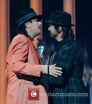 Carlos Santana and Juanes