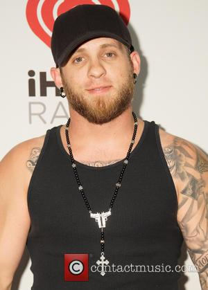 Brantley Gilbert Given Purple Heart From Veteran Fan