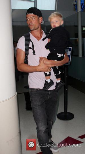 Josh Duhamel and Axl Duhamel - Fergie, her husband Josh and their son Axl at Los Angeles International Airport (LAX)...
