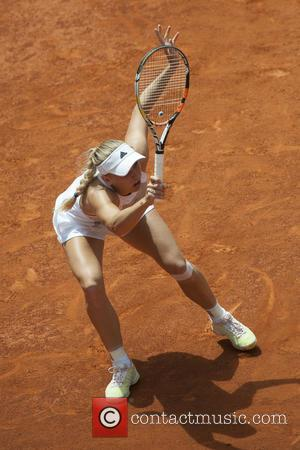 Caroline Wozniacki - Caroline Wozniacki in action during her second round match against Chrisitina McHale on day two of the...