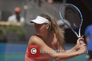 Maria Sharapova - Maria Sharapova of Russia in action against Caroline Garcia of France during day five of the Mutua...