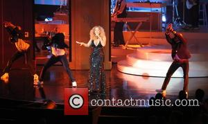 Shots of American pop super stars Mariah Carey as she performs live on stage as part of her 'Mariah #1...