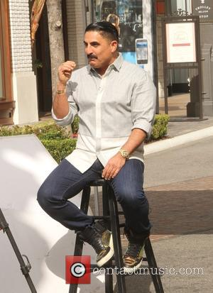 Reza Farahan - Shahs of Sunset actor, Reza Farahan sitting on a stool, does an interview at The Grove in...