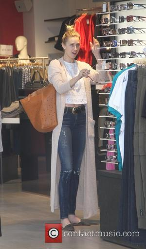 Whitney Port - Whitney Port wearing a long maxi cardigan, goes shopping in Beverly Hills - Los Angeles, California, United...