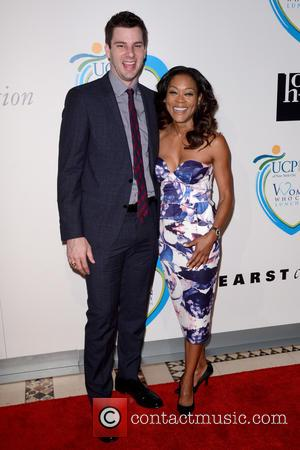Tim Morehouse and Robin Givens