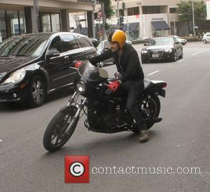 Olivier Martinez - Olivier Martinez rides his motorbike after he leaves a bank in Beverly Hills - Los Angeles, California,...