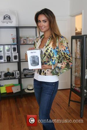 Katie Cleary - Katie Cleary visits Indulge House gifting suite in Beverly Hills. She is gifted Sharkk bluetooth speakers amongst...