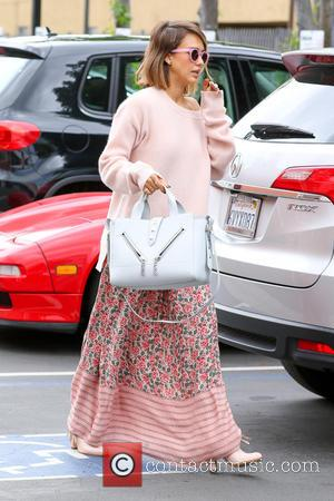 Jessica Alba - Jessica Alba arriving at a studio wearing a full length pink floral outfit with a matching sweater,...