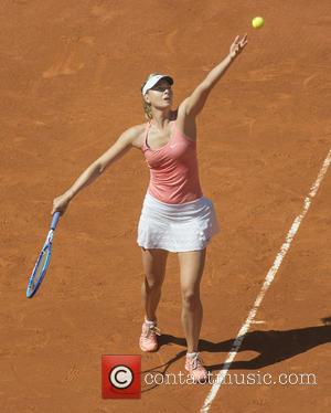 Maria Sharapova - Maria Sharapova in action during her semi final match against Svetlana Kuznetsova on day seven of the...