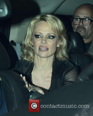 Pamela Anderson - Pamela Anderson, wearing a sheer black dress, leaves Crossroads Vegan Restaurant with friends at Crossroads Vegan Restaurant...